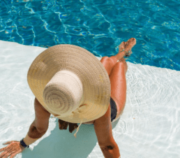 Esthederm Photo_Women, poolside, summer, beach hat, swimming, sunscreen, professional skincare, Esthederm Canada